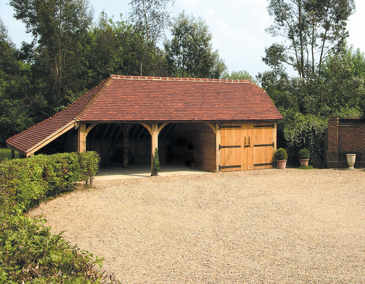 This traditional three-bay (frame C-4) incorporates a full-length logstore giving additional covered space.