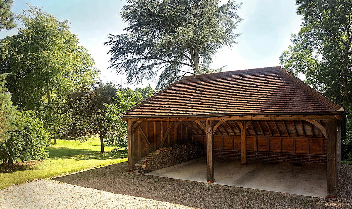 A SuperSize oak frame with an oak roof. Felt was not used in the roof, allowing the beauty of the hand-made clay tiles to be visible from the inside of the building.