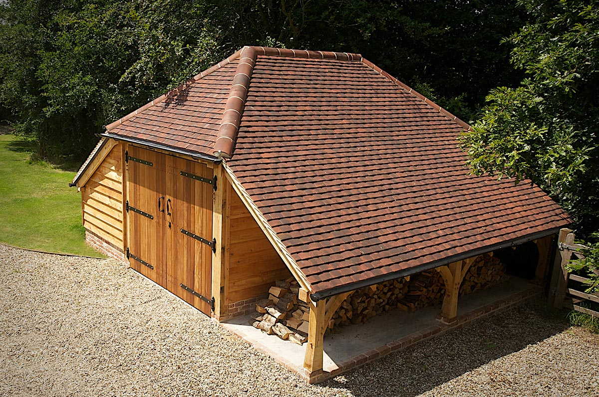 This one-bay cart barn in Newbury, Berkshire, has internal and external log stores.