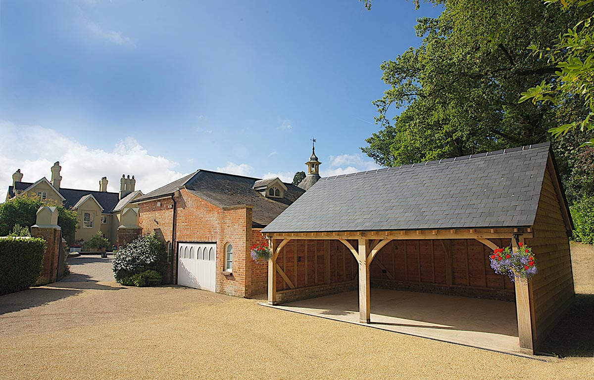 This two-bay cart barn with a natural slate roof sits pretty in a rural setting in Romsey, Hampshire.
