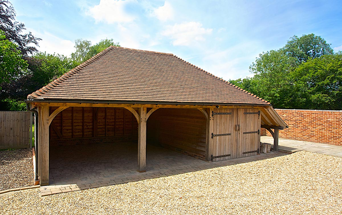 Oak garages from the brookwood barn company for 3 bay garage cost