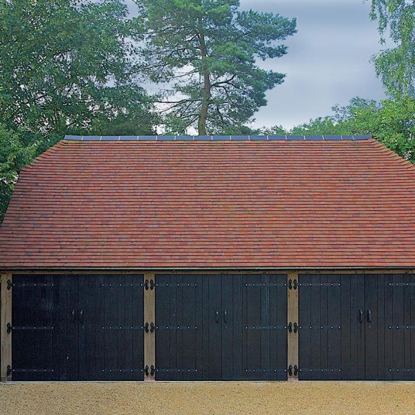 This oak frame has barn hip end roof, finished in a clay tile with a contrasting clay ridge.